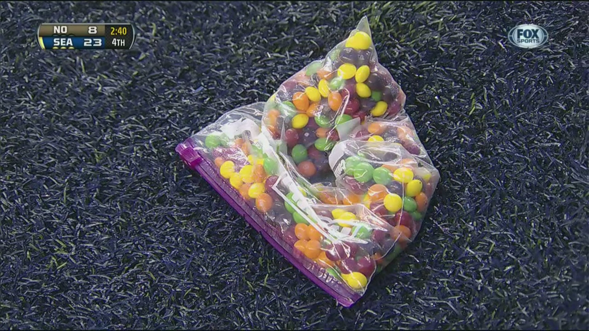 Marshawn Lynch diving into Skittles