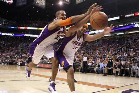 PHOENIX, AZ - APRIL 13:  Grant Hill #33 and Jared Dudley #3 of the Phoenix Suns reach for a loose ball during the NBA game against the San Antonio Spurs at US Airways Center on April 13, 2011 in Phoenix, Arizona.  (Photo by Christian Petersen/Getty Images)