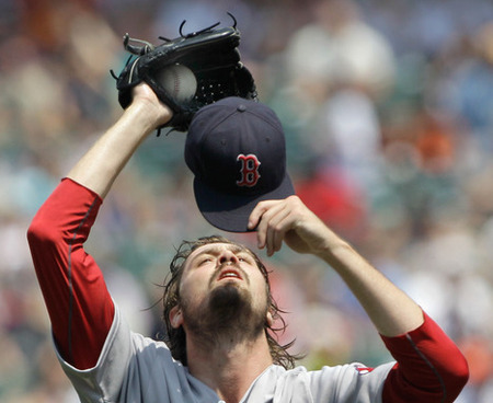 BALTIMORE, MD - JULY 20: Starting pitcher Andrew Miller #30 of the Boston Red Sox looks hungrily at his hat.