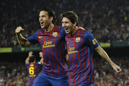BARCELONA, SPAIN - SEPTEMBER 17:  Lionel Messi of FC Barcelona (R) celebrates with his teammate Cesc Fabregas after scoring his first goal during the La Liga soccer match between FC Barcelona and CA Osasuna at Camp Nou Stadium on September 17, 2011 in Barcelona, Spain.  (Photo by David Ramos/Getty Images)
