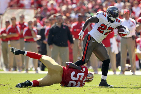 SAN FRANCISCO, CA - OCTOBER 09:  LeGarrette Blount #27 of the Tampa Bay Buccaneers is tackled by  Patrick Willis #52 of the San Francisco 49ers at Candlestick Park on October 9, 2011 in San Francisco, California.  (Photo by Ezra Shaw/Getty Images)