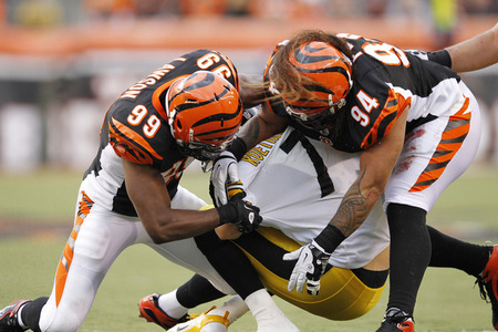 CINCINNATI, OH - NOVEMBER 13: Ben Roethlisberger #7 of the Pittsburgh Steelers gets sacked by Manny Lawson #99 and Domata Peko #94 of the Cincinnati Bengals at Paul Brown Stadium on November 13, 2011 in Cincinnati, Ohio. The Steelers won 24-17. (Photo by Joe Robbins/Getty Images)