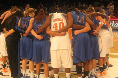 DePaul Blue Demons and Tennessee Lady Vols players meet at center court after their meeting at the Maggie Dixon Classic at Madison Square Garden on Sunday. Photo by Ray Floriani.