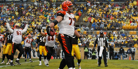 PITTSBURGH - DECEMBER 12: Andrew Whitworth #77 of the Cincinnati Bengals celebrates after scoring a touchdown against the Pittsburgh Steelers during the game on December 12 2010 at Heinz Field in Pittsburgh Pennsylvania.  (Photo by Jared Wickerham/Getty Images)