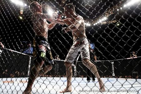 "Nate Diaz boxes up Donald Cerrone at UFC 141 with his Stockton striking style, which is ""vexing and paralyzing"" for opponents who decide to stand and trade with him. Photo by Esther Lin for MMA Fighting."