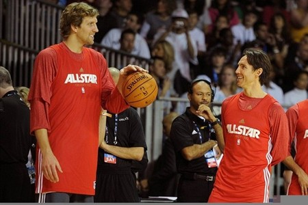 Feb 25, 2012; Orlando, FL, USA; Western Conference forward Dirk Nowitzki of the Dallas Mavericks (left), Steve Nash of the Phoenix Suns (right) chat during the 2012 NBA All-Star team practice session at the Orange County Convention Center. Mandatory Credit: Bob Donnan-US PRESSWIRE