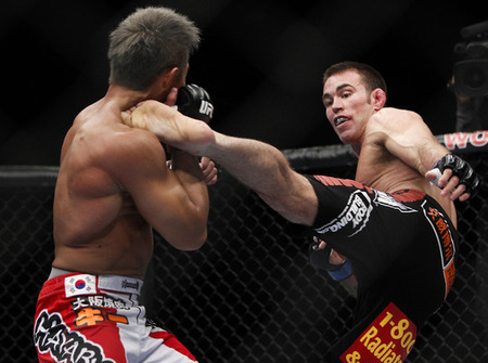 Jake Shields throws a high kick at Yoshihiro Akiyama at UFC 144 on Feb. 25, 2012 in Saitama, Japan. Photo by Esther Lin via MMA Fighting