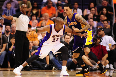 Apr. 7, 2012; Phoenix, AZ, USA; Phoenix Suns guard (22) Michael Redd drives to the basket against Los Angeles Lakers forward (9) Matt Barnes in the first half at the US Airways Center. Mandatory Credit: Mark J. Rebilas-US PRESSWIRE