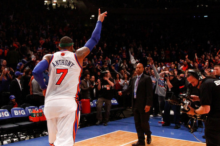 Apr. 8, 2012; New York, NY, USA; New York Knicks small forward Carmelo Anthony (7) runs off the court after winning the game against the Chicago Bulls at Madison Square Garden. Knicks won in overtime 100-99. Mandatory Credit: Debby Wong-US PRESSWIRE