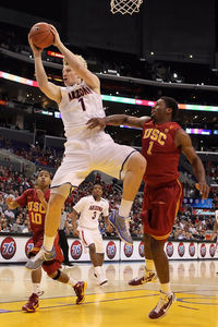 Kyryl Natyazhko #1 of the Arizona Wildcats grabs a rebound over Alex Stepheson #1 of the USC Trojans in the first half in the semifinals of the 2011 Pacific Life Pac-10 Men's Basketball Tournament at Staples Center on March 11, 2011 in Los Angeles, California.  (Photo by Jeff Gross/Getty Images)