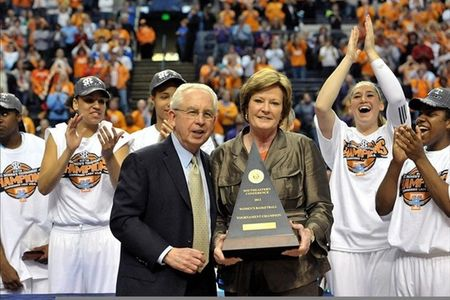 Mar 4, 2012; Nashville,TN, USA; Tennessee Lady Volunteers head coach Pat Summitt receives the championship trophy from SEC commissioner Mike Slive after her team defeated the LSU Tigers 70-58 during the finals of the 2012 SEC Tournament at Bridgestone Arena. Jim Brown-US PRESSWIRE