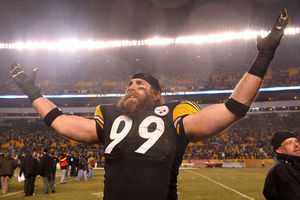 PITTSBURGH PA - JANUARY 15:  Defensive end Brett Keisel #99 of the Pittsburgh Steelers celebrates after defeating the Baltimore Ravens 31-24 in the AFC Divisional Playoff Game at Heinz Field on January 15 2011 in Pittsburgh Pennsylvania.  (Photo by Nick Laham/Getty Images)