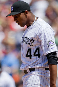 DENVER, CO - MAY 6:  Starting pitcher Juan Nicasio #44 of the Colorado Rockies reacts after giving up a three-run home run to Freddie Freeman of the Atlanta Braves during the third inning at Coors Field on May 6, 2012 in Denver, Colorado.  (Photo by Justin Edmonds/Getty Images)