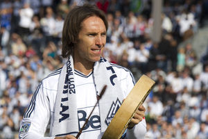 VANCOUVER, BC - MARCH 19:  NBA star Steve Nash  of the Phoenix Suns and part owner of the Vancouver Whitecaps beats a drum before the match against Toronto FC March 19, 2011 in Vancouver, British Columbia, Canada.  (Photo by Jeff Vinnick/Getty Images)