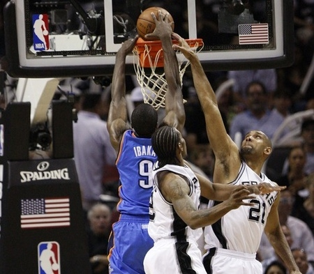May 27, 2012; San Antonio, TX, USA; Oklahoma City Thunder forward Serge Ibaka (9) drives to the basket as San Antonio Spurs forward Kawhi Leonard (2) and Tim Duncan (21) defend during the second half in game one of the Western Coneference finals of the 2012 NBA playoffs at the AT&T Center.  Mandatory Credit: Soobum Im-US PRESSWIRE