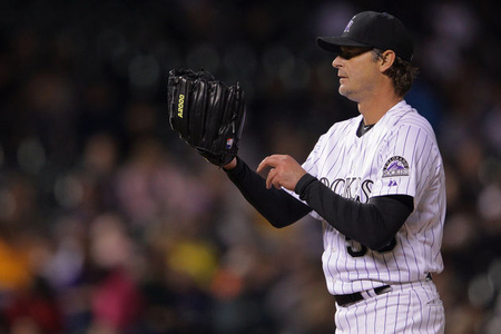 DENVER, CO - APRIL 17:  Starting pitcher Jamie Moyer #50 of the Colorado Rockies delivers against the San Diego Padres at Coors Field on April 17, 2012 in Denver, Colorado. Moyer became the oldest player in the major leagues to record a win as the Rockies defeated the Padres 5-3.  (Photo by Doug Pensinger/Getty Images)