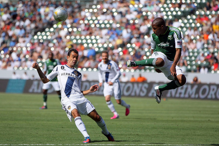 CARSON, CA - JUNE 17:  Darlington Nagbe #6 of the Portland Timbers volleys the ball over Juninho #19 of the Los Angeles Galaxy in the first half during the MLS match at The Home Depot Center on June 17, 2012 in Carson, California. The Galaxy defeated the Timbers 1-0.  (Photo by Victor Decolongon/Getty Images)