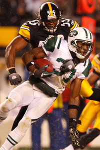 PITTSBURGH - DECEMBER 19:  Antonio Cromartie #31 of the New York Jets is tackled by Stevenson Sylvester #55 of the Pittsburgh Steelers during the game on December 19 2010 at Heinz Field in Pittsburgh Pennsylvania.  (Photo by Jared Wickerham/Getty Images)