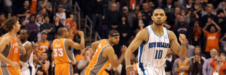 PHOENIX, AZ - DECEMBER 26:  Eric Gordon #10 of the New Orleans Hornets celebrates after scoring the game winning basket against the Phoenix Suns during the season openning NBA game at US Airways Center on December 26, 2011 in Phoenix, Arizona.  The Hornets defeated the Suns 85-84. NOTE TO USER: User expressly acknowledges and agrees that, by downloading and or using this photograph, User is consenting to the terms and conditions of the Getty Images License Agreement.  (Photo by Christian Petersen/Getty Images)