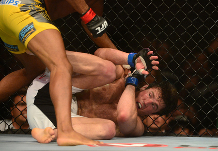 Jul. 7, 2012; Las Vegas, NV, USA; UFC fighter Chael Sonnen on the ground against Anderson Silva during a middleweight bout in UFC 148 at the MGM Grand Garden Arena. Mandatory Credit: Mark J. Rebilas-US PRESSWIRE