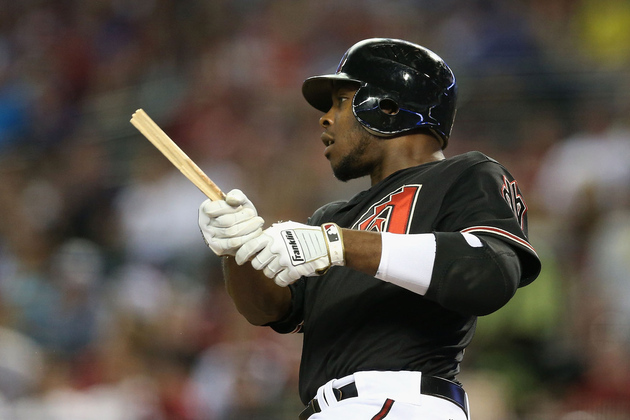PHOENIX, AZ - Justin Upton #10 of the Arizona Diamondbacks breaks his bat as he hits against the Los Angeles Dodgers during the MLB game at Chase Field.  (Photo by Christian Petersen/Getty Images)
