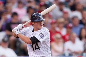 DENVER, CO - JULY 13:  Josh Rutledge #14 of the Colorado Rockies bats in the second inning against the Philadelphia Phillies at Coors Field on July 13, 2012 in Denver, Colorado.  Rutledge made his Major League debut and went two-for-two on the day including two RBI's. (Photo by Justin Edmonds/Getty Images)