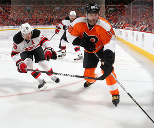 PHILADELPHIA, PA - APRIL 29: Jaromir Jagr #68 of the Philadelphia Flyers carries the puck past Patrik Elias #26 of the New Jersey Devils in Game One of the Eastern Conference Semifinals during the 2012 NHL Stanley Cup Playoffs at the Wells Fargo Center on April 29, 2012 in Philadelphia, Pennsylvania. (Photo by Jim McIsaac/Getty Images)