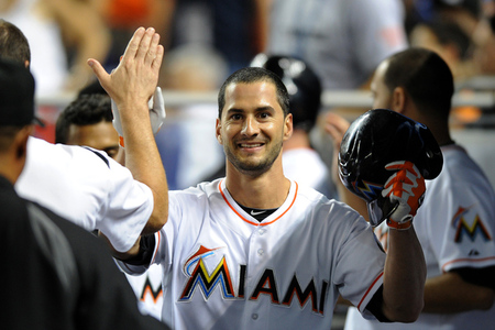 July 28, 2012; Miami, FL, USA; Miami Marlins center fielder Justin Ruggiano (center) is greeted by teammates after hitting a solo home run during the seventh inning against the San Diego Padres at Marlins Park. The Marlins won 4-2. Mandatory Credit: Steve Mitchell-US PRESSWIRE