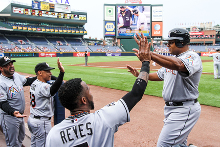 August 1, 2012; Atlanta, GA, USA; Miami Marlins first baseman Carlos Lee (45) celebrates scoring a run with shortstop Jose Reyes (7) in the first inning against the Atlanta Braves at Turner Field. Mandatory Credit: Daniel Shirey-US PRESSWIRE