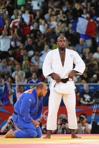 Aug 3, 2012; London, United Kingdom;  Teddy Riner (FRA), in white, defeats Faicel Jaballah (TUN), in blue, during the men's +100kg elimination round of 16 in the London 2012 Olympic Games at ExCel-North Arena 2. Mandatory Credit: James Lang-USA TODAY Sports