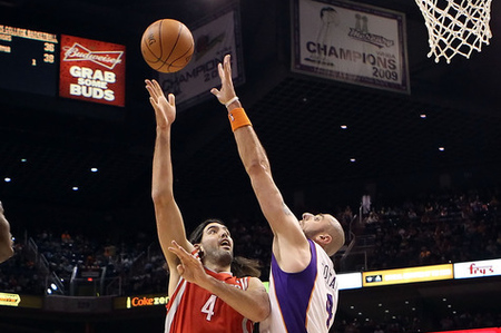 PHOENIX, AZ - FEBRUARY 09:  Luis Scola #4 of the Houston Rockets puts up a shot over Marcin Gortat #4 of the Phoenix Suns during the NBA game at US Airways Center on February 9, 2012 in Phoenix, Arizona.  NOTE TO USER: User expressly acknowledges and agrees that, by downloading and or using this photograph, User is consenting to the terms and conditions of the Getty Images License Agreement.  (Photo by Christian Petersen/Getty Images)