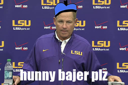 An ecstatic Les Miles greeted the press in his favorite hat.