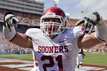 DALLAS, TX - OCTOBER 8:   Tom Wort #21 of the Oklahoma Sooners  celebrates after a touchdown against the Texas Longhorns at the Cotton Bowl on October 8, 2011 in Dallas, Texas.  The Sooners defeated the Longhorns 55 to 17.  (Photo by Wesley Hitt/Getty Images)