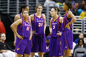 Former Phoenix Mercury center Brooke Smith (center) didn't get off the bench often in her WNBA career, but she  will forever hold a spot in many Merc fan's hearts. Photo by Craig Bennett/112575 Media.