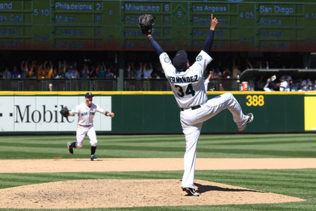 SEATTLE, WA - AUGUST 15: Starting pitcher Felix Hernandez #34 of the Seattle Mariners celebrates after throwing a perfect game against the Tampa Bay Rays at Safeco Field on August 15, 2012 in Seattle, Washington. (Photo by Otto Greule Jr/Getty Images)