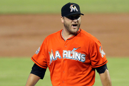 MIAMI, FL - SEPTEMBER 02:  Pitcher Mark Buehrle #56 of the Miami Marlins reacts after giving up a grand slam home run against the New York Mets  at Marlins Park on September 2, 2012 in Miami, Florida.  (Photo by Marc Serota/Getty Images)