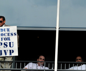 "STATE COLLEGE, PA - SEPTEMBER 01: Former Penn State Nittany Lion football player Franco Harris (far right), sits with a cardboard cutout of former Penn State football coach Joe Paterno in his sky box with a sign reading ""Due Process for PSU JVP"" during play between the Penn State Nittany Lions and the Ohio University Bobcats at Beaver Stadium on September 1, 2012 in State College, Pennsylvania. (Photo by Patrick Smith/Getty Images)"