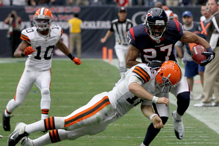 HOUSTON, TX - NOVEMBER 06: Safety Quintin Demps #27 of the Houston Texans intercepts the ball and is tackled by Quarterback Colt McCoy #12 of the Cleveland Browns on November 6, 2011 at Reliant Stadium in Houston, Texas. (Photo by Thomas B. Shea/Getty Images)