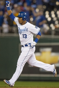 KANSAS CITY, MO - SEPTEMBER 15:  Catcher Salvador Perez #13 of the Kansas City Royals rounds the bases after hitting a game winning home run in the ninth inning of a game against the Los Angeles Angels of Anaheim at Kauffman Stadium on September 15, 2012 in Kansas City, Missouri.  The Royals defeated the Angels 3-2.  (Photo by Tim Umphrey/Getty Images)