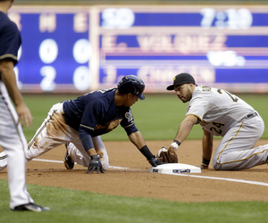 Carlos Gomez of the Milwaukee Brewers steals third base against the Pittsburgh Pirates at Miller Park in Milwaukee, Wisconsin. (Photo by Mike McGinnis/Getty Images)