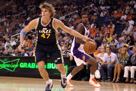 PHOENIX - OCTOBER 12:  Andrei Kirilenko #47 of the Utah Jazz drives the ball past Earl Clark #55 of the Phoenix Suns during the preseason NBA game at US Airways Center on October 12, 2010 in Phoenix, Arizona. (Photo by Christian Petersen/Getty Images)