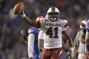 GAINESVILLE FL - NOVEMBER 13:  Josh Dickerson #41 of the South Carolina Gamecocks holds up the ball after recovering a fumble during a game against the Florida Gators at Ben Hill Griffin Stadium on November 13 2010 in Gainesville Florida.  (Photo by Mike Ehrmann/Getty Images)