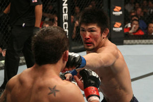 Michihiro Omigawa and Chad Mendes go toe-to-toe at UFC 126. Photo by Jed Jacobsohn/Zuffa LLC/Zuffa LLC via Getty Images