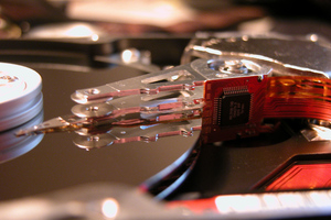 hard drive platter actuator arm (flickr lyrandian)