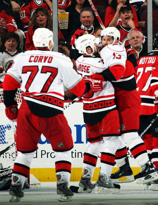 Ray-whitney-13-of-the-carolina-hurricanes-is-hoisted-in-celebration