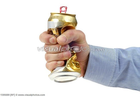 Close-up_of_persons_hand_crushing_beer-can_1305589_medium