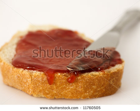 Stock-photo-slice-of-bread-with-jam-spread-and-knife-11760505_medium