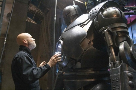 Obadiah-stane-jeff-bridges-surveys-the-iron-monger-armor-in-iron-man