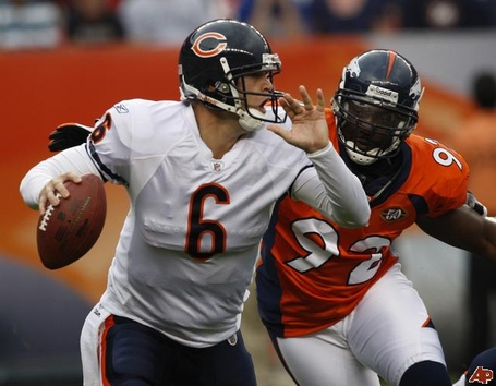 Jay-cutler-elvis-dumervil-2009-8-30-21-10-40_medium