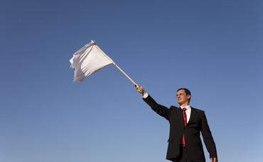 Businessman-white-flag-370x229_medium